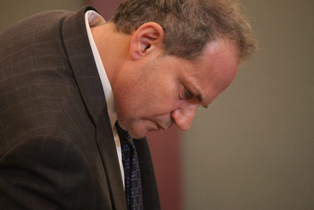 Nick Donath Reviewing Notes at Trial